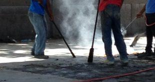 Personal técnico de TECNOSPORTS aplicando de calor para levantamiento de pintura en superficie